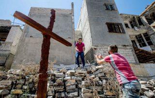 Reconstrução da habitação, escola e igreja ortodoxa grega de St. George, o antigo bairro da cidade de Homs (Síria)