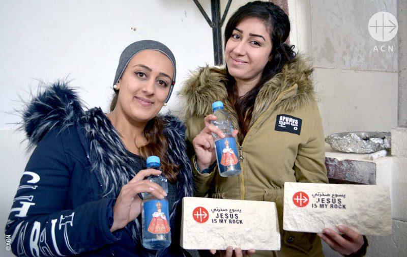 Cristãos na Síria comemoram retorno e cerimônia que marca a reconstrução de suas casas