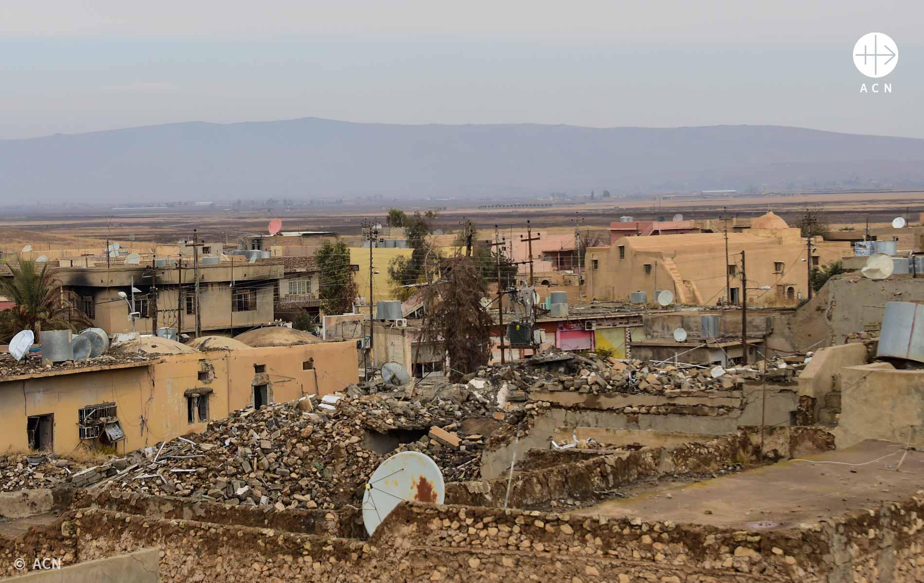 Foto da região do Iraque com casas destruídas